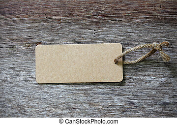 blank price tag label on wooden background