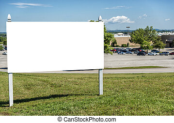 Blank Real Estate Sign in Front of Retail Complex