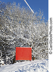 Blank red billboard in the snow