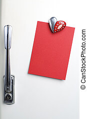 Blank red note on fifties fridge-door, heart shaped-magnet,...