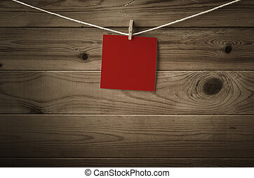 Blank Red Note Paper Pegged to String against Wood Planks