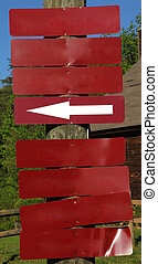 Blank Red Signs on Wooden Post