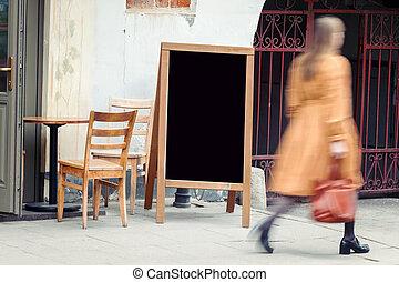 Blank restaurant blackboard with pedestian