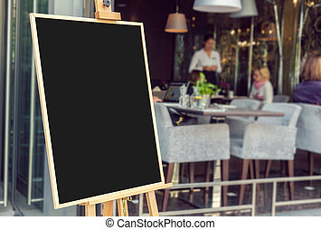 Blank restaurant menu blackboard with blury people