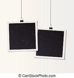 Blank retro vintage photo frame set hanging on a clip.
