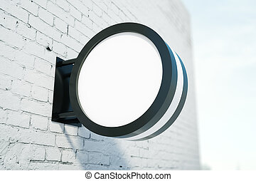 Blank round stopper on white brick building. Advertisement...