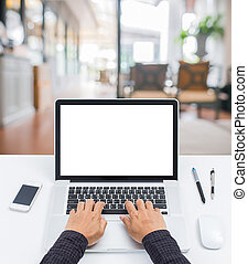 Blank screen laptop computer with blur leaving room background