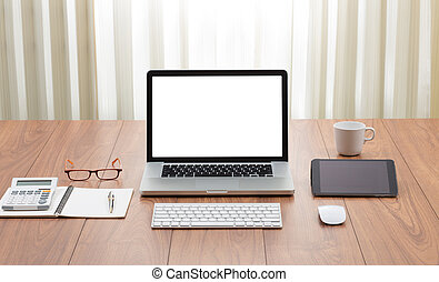 Blank screen laptop computer with office accessories on wooden t