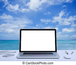 Blank screen laptop computer with sea background