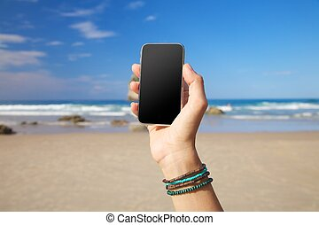 blank screen mobile in the beach
