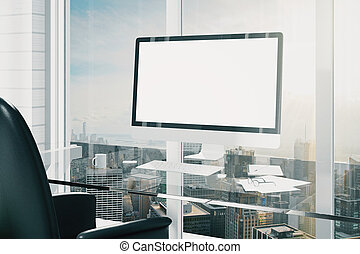 Blank screen of computer monitor on glassy table, mock up
