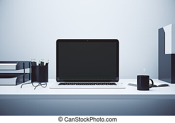 Blank screen of laptop on the table with glasses and cup of coffee, mock up