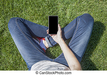 blank screen phone legged on grass