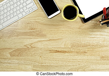 blank screen smartphones and tablet PC on the wooden desktop with computer keyboard and a cup of coffee in composition with copy space for your text
