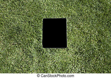 blank screen tablet on grass