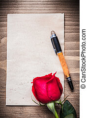 Blank sheet of paper expanded rose fountain pen holiday concept