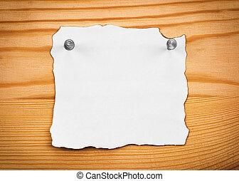 blank sheet of paper on a wooden board