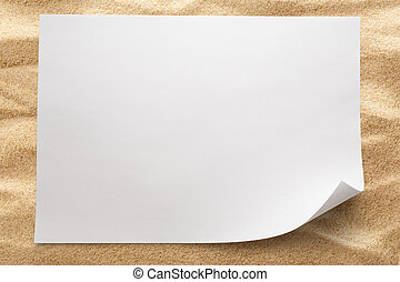 Blank sheet of paper on sand