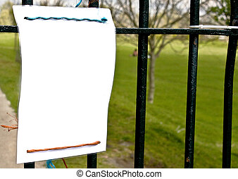 blank sign hanging on railings.