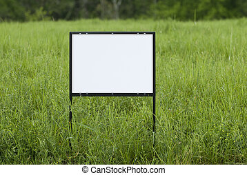 Blank Sign In Overgrown Field