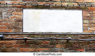 blank sign on brick wall