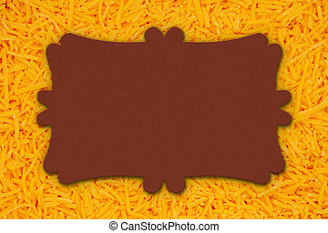 Blank sign on shredded cheddar cheese in pile background