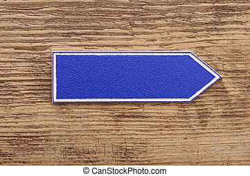 blank sign on wooden background