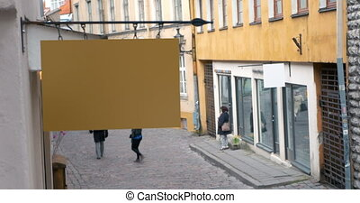 Shot of a blank signage over the empty pedestrian street of Tallinn, Estonia.