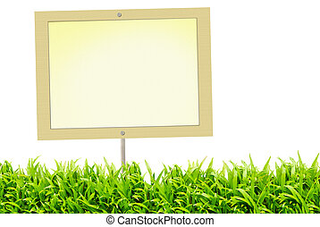 Blank signboard and green grass