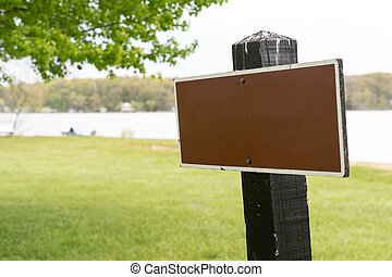 Blank signboard at park outdoor with copy space for text