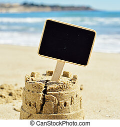 blank signboard topping a sandcastle