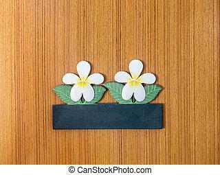 Blank signboard with design of flower on the door
