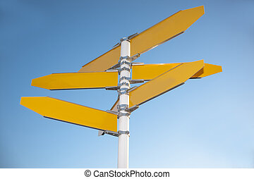 Blank Signpost, - Blank signpost with seven arrows over blue...