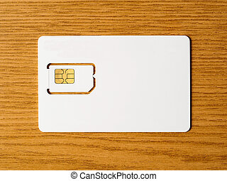 Blank SIM card on wooden surface, ready for your...