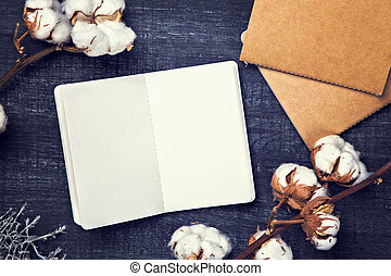 Blank sketchbook on a wooden background