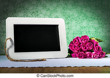 blank slate blackboard and roses