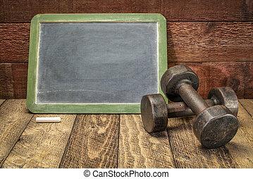 blank slate blackboard sign with dumbbells