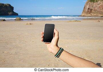 blank smartphone in the beach