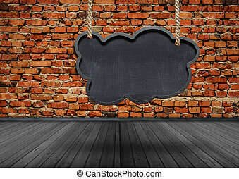 Blank speech bubbles hanging from a cord in old room interior