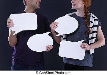 Blank speech bubbles - Man and woman holding blank speech...