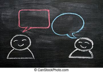 Blank speech bubbles with cartoon figures drawn on a blackboard background