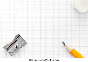 Photo of blank squared graph paper with a yellow pencil, eraser and sharpener, add your own text or diagram.