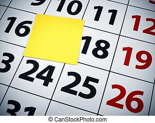 Blank sticky note on a calendar
