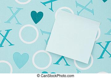 Blank sticky note on blue love paper