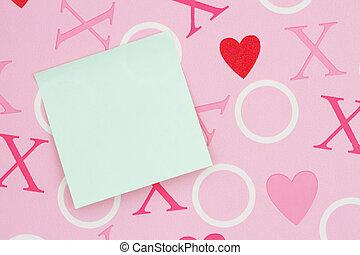 Blank sticky note on pink love paper
