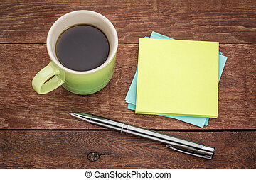 blank sticky notes and coffee