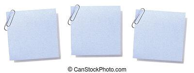 Blank Sticky Notes - Blank, paperclipped blue sticky notes.