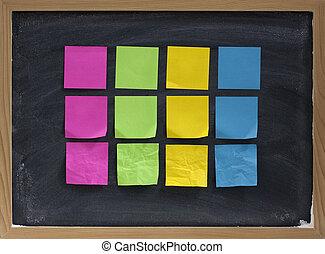 blank sticky notes on blackboard