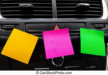 blank sticky notes on car dashboard