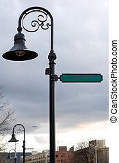 Blank Street Sign - A blank street sign and lamp post with...
